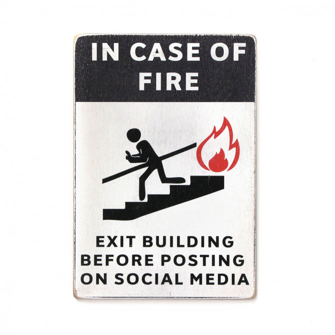 "Постер ""In case of fire exit building before posting on social media"""